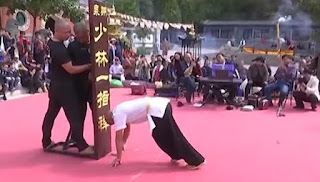 The Monk, preparing for the one finger stand.