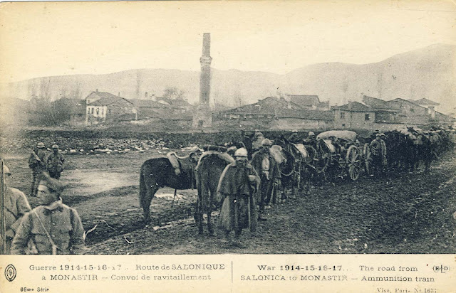 "A convoy of ammunition enters into the city. In the background is the settlement ""Bela Cesma"" White Fountain and on right of the convoy are Turkish cemetery."