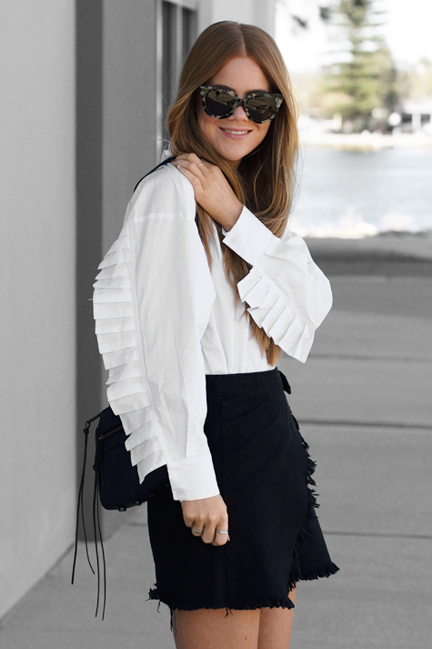 lion in the wild, kiara king, white button up shirt frill sleeve, denim wrap skirt