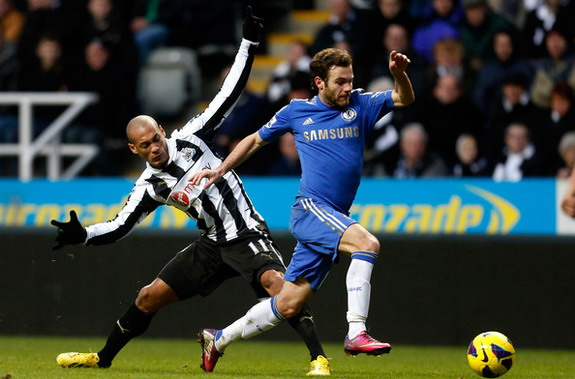 Juan Mata of Chelsea in action with Newcastle player Yoan Gouffran