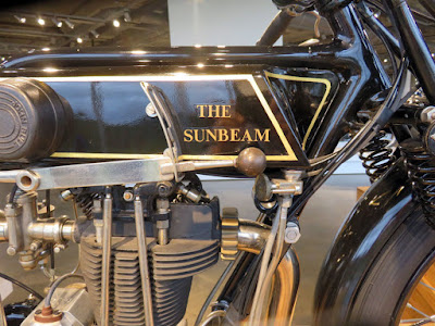 "Flat tank of motorcycle is labelled ""The Sunbeam."""