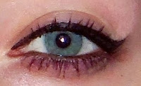 wingged liquid eyeliner blue green silver eyes pinup girl makeup tutorial mascara