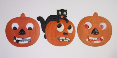 Trio of pumpkins and a black cat are credited as early century German production.