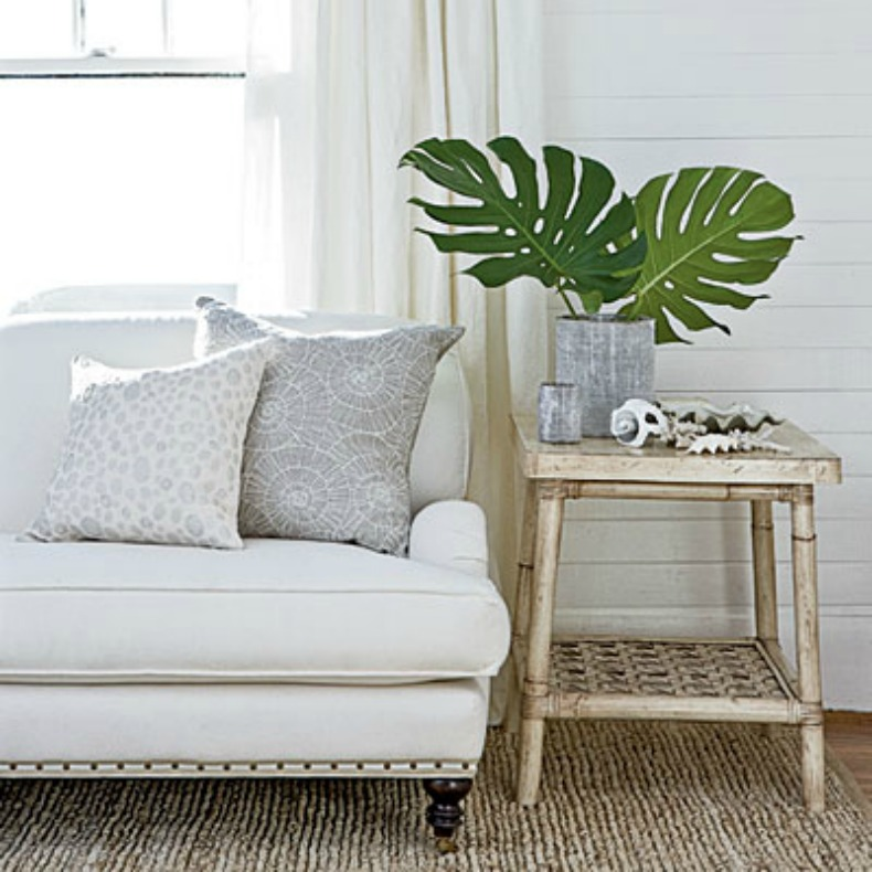 Coastal living room with white sofa and weathered wood side table