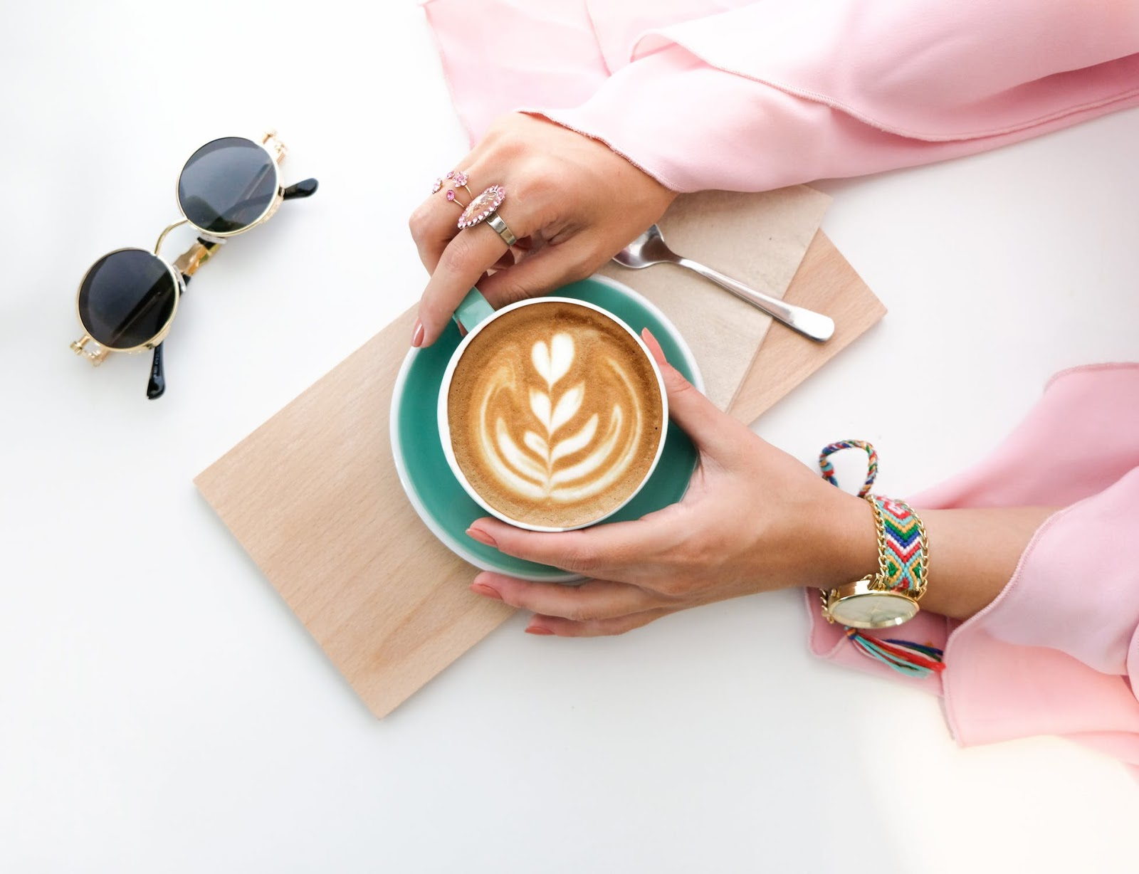 woman drinking a latte from a coffee shop