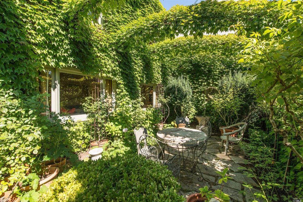Ivy covered California home of Myra Hoefer with lush gardens and French inspired interiors