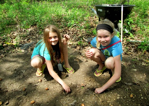 Tessa and her friend took turns planting fifty iris bulbs. I hope to return with them in the fall to plant daffodils.