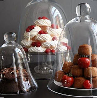 Pastries displayed under glass bell jar cloches