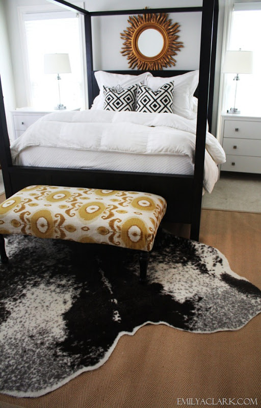 Cowhides Layered Over Natural Fiber Rugs | Driven by Decor