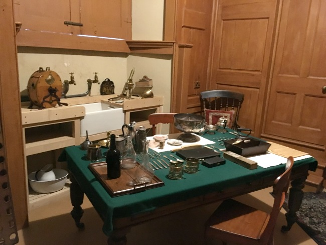 table-with-silver-ware-and-cleaning-products-and-sink-Butlers-pantry-St-Fagans-Castle