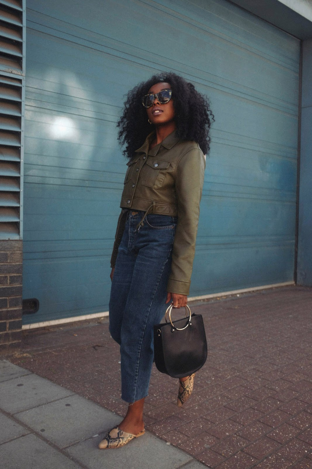 Missguided khaki faux leather super crop trucker jacket Kiliwatch vintage Lee jeans Forever21 gold handle bag H&M oversized sunglasses H&M snake print slip on mules Havana jumbo twist crochet hair