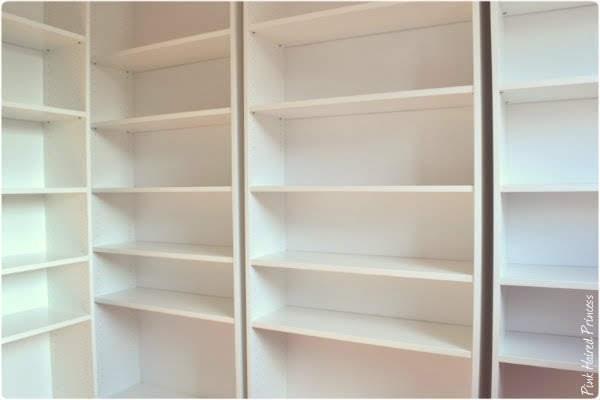 wall of white shelving for shoe closet