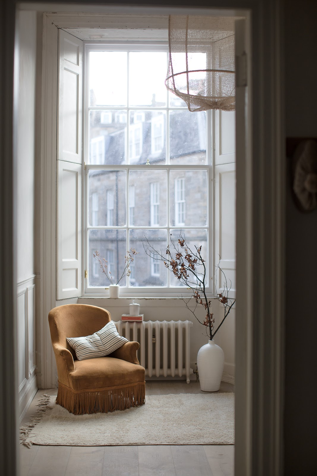 ilaria fatone - a comforting and minimal home - the cozy corner beside the window
