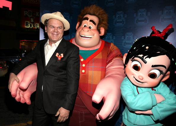John C. Reilly standing with a model of his character Wreck-It Ralph animatedfilmreviews.filminspector.com