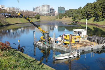 Sakurada Moat, Imperial Palace, Tokyo, Japan, with up-close of a barge doing repair work.