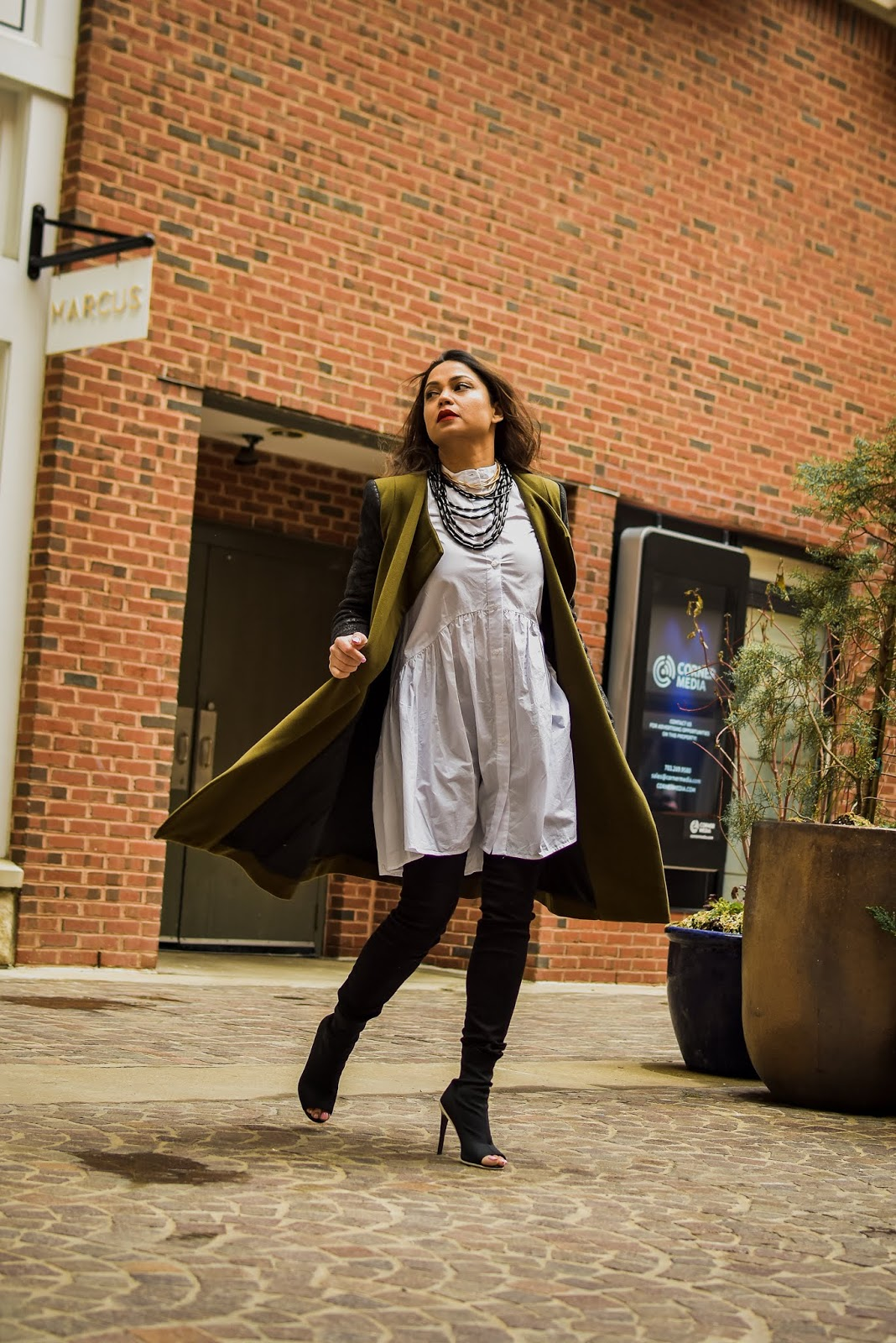 white and black outfit, necklaces stacked, neck candy, street style, black gap jeans, white tunic dress outfit, fashion, style, myriad musings, fenty beauty uncensored red lipstick, green military coat, saumya shiohare