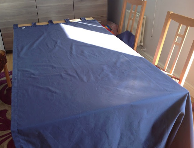 Curtain on a work surface. A dining room table