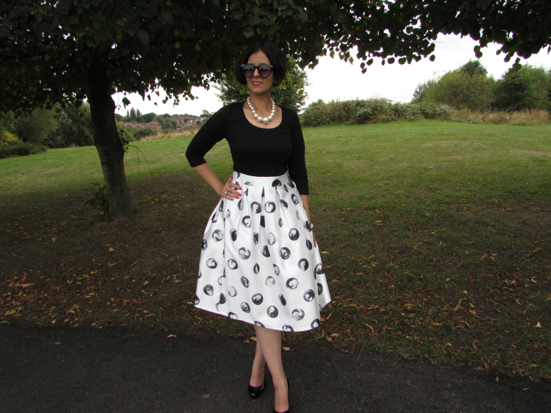 Monochrome look ft dotted full midi skirt