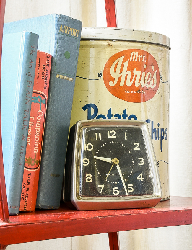 vintage books, old clock and potato chip tin