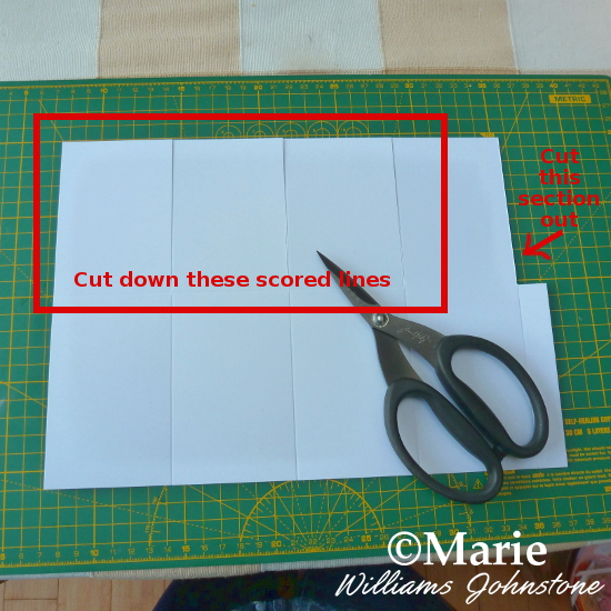 Cutting scored lines of a sheet of card to make a special boxed pop up card
