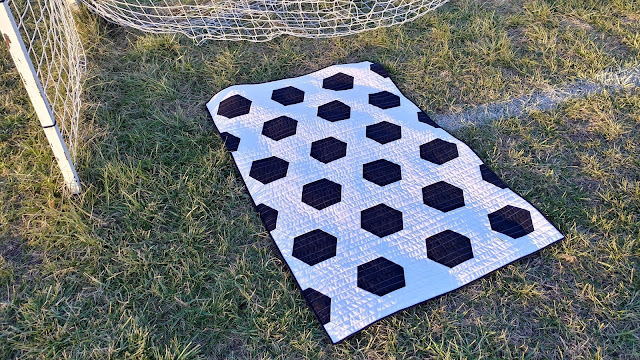 Soccer quilt made with half hexagons