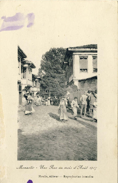 "Street ""Dimitar Vlahov"" with view toward the ""Cinar"" tree in August 1917. Postcard issued by Moulis France. A group of French soldiers is in the foreground, and another group behind them sightseeing."