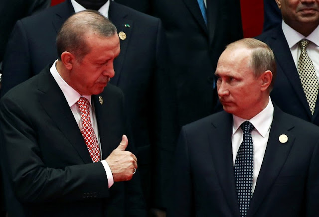 Image Attribute: Russia's President Vladimir Putin interacts with Turkey's President Tayyip Erdogan as they pose for a group picture during the G20 Summit in Hangzhou, Zhejiang province, China September 4, 2016. REUTERS/Damir Sagolj