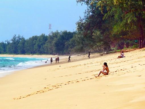 Tourists on Phuket Mai Khao beach