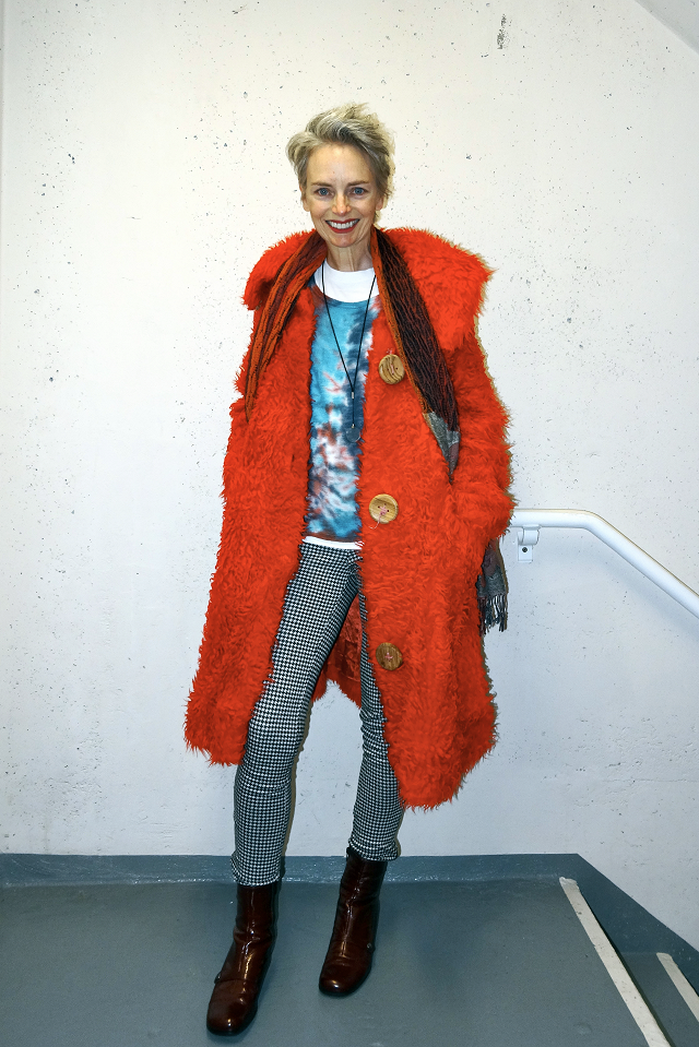 Melanie Kobayashi in shaggy red coat, heh, bag and a beret