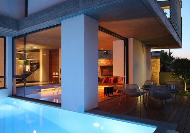 model rumah minimalis tampak depan dengan batu alam dan kolam renang