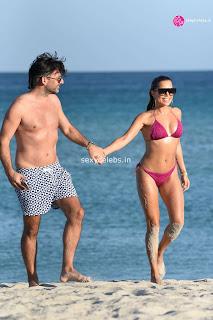 Sylvie Meis  body huge    in tiny bikini WOW Beach Side  Pics Celebs.in Exclusive 016