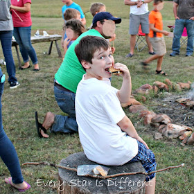 The birthday boy at his campfire themed birthday party