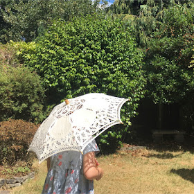 Keeping our autistic kids cool - a girl holding parasol