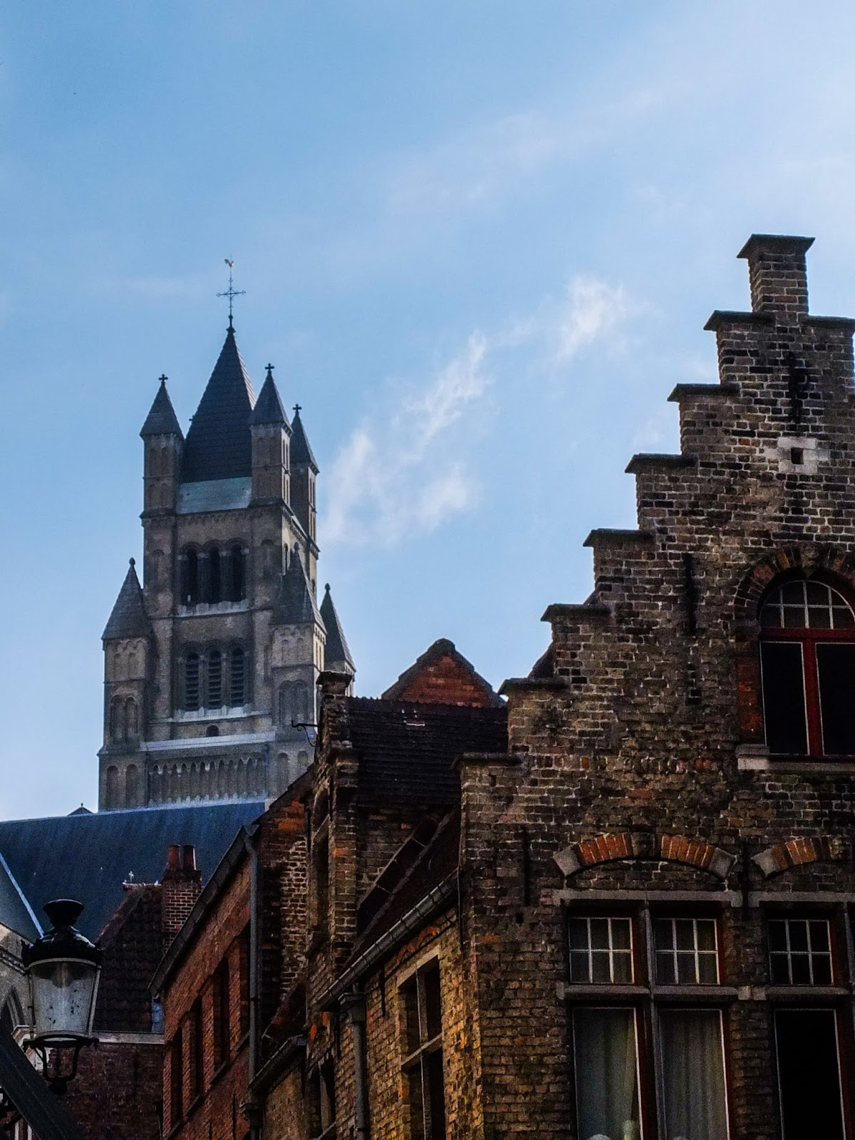 The St.Salvator Cathedral in Bruges showing behind other medieval buildings.
