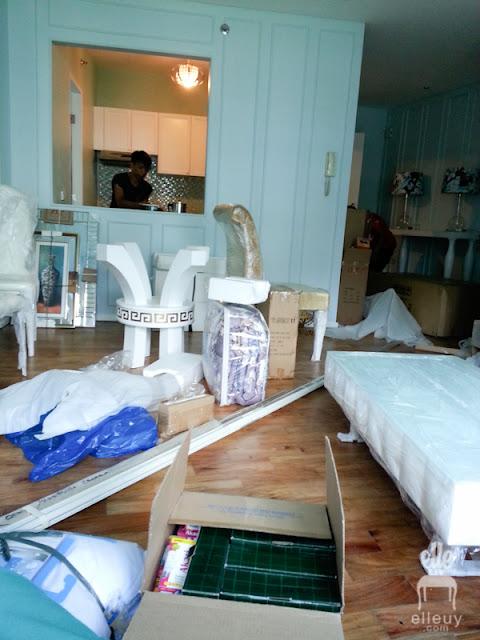 messy living room, blue walls, wall molding