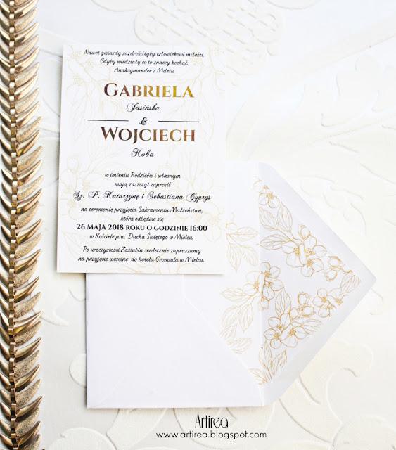 Eleganckie, delikatne bialo-zlote zaproszenia ślubne pozlacane artirea