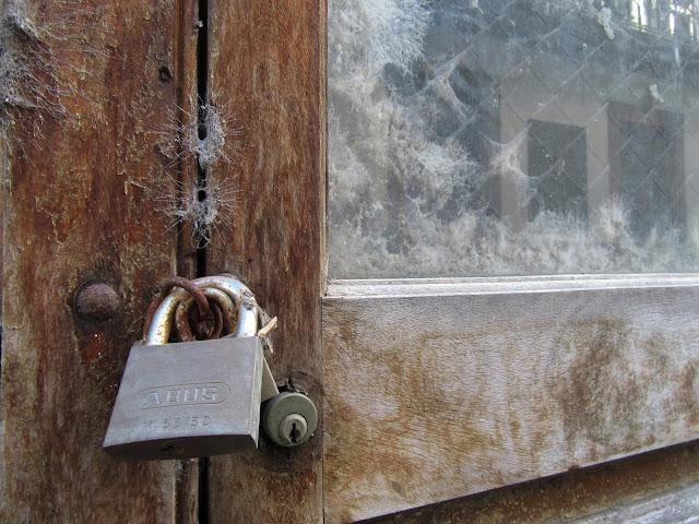 a padlock in an old door