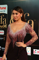 Hansika Motwani in Glittering Deep Neck Transparent Leg Split Purple Gown at IIFA Utsavam Awards 37.JPG