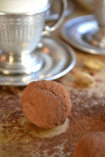 A cardamom coffee truffle with a Turkish coffee cup