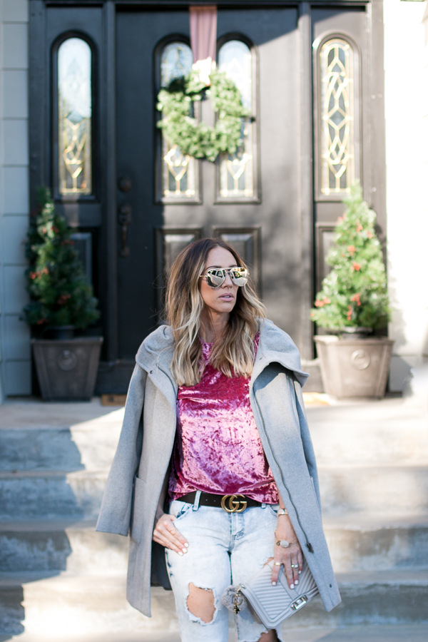 pink crushed velvet top with ripped jeans