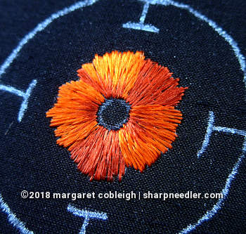Piper's silk version of the embroidered remembrance poppy with completed red portion of petals
