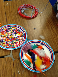 beads, feathers, plastic plates for dream catchers- Native American craft