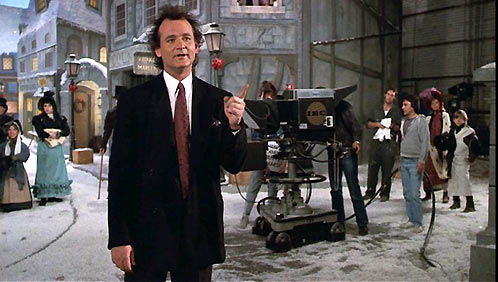 Bill Murray as Frank Cross in Scrooged 1988 movieloversreviews.filminspector.com