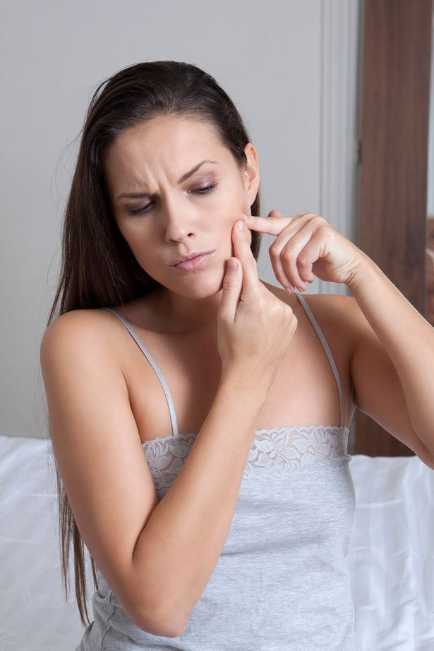 Woman popping zits
