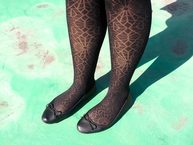 Witch Halloween Outfit | shoe details of black flat ballet pumps with bow details, worn with black spider web pattern tights