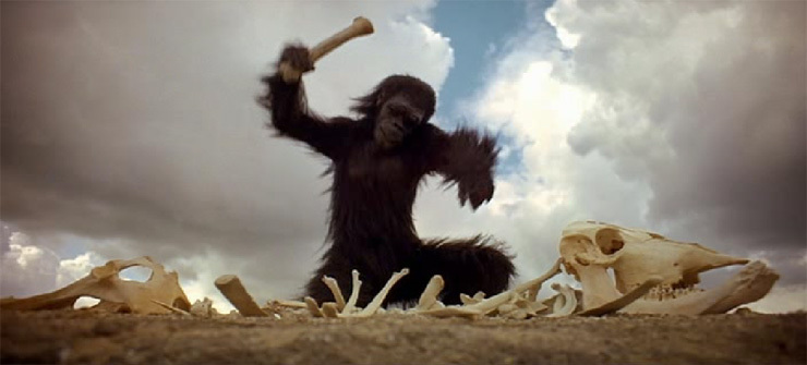 An ape uses a bone to bash a skeleton in 2001: A Space Odyssey movieloversreviews.blogspot.com