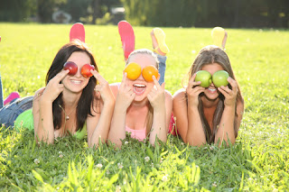 Teenage girls with fruit for eyes