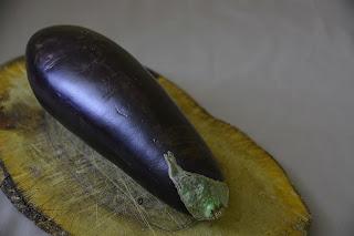 Long, straight, purple eggplant
