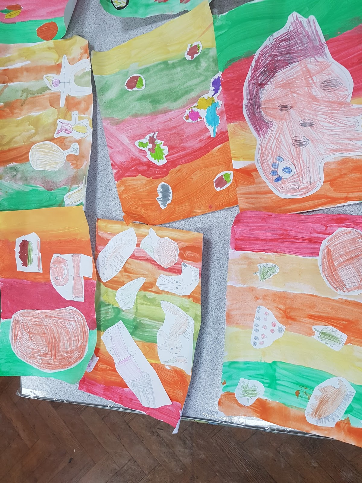 Then We Drew Our Own Autumn Pictures And Painted An Background Using A Range Of Colours To Stick On