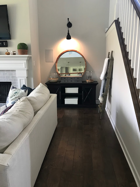 matching furniture on both sides of fireplace